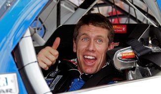 Carl Edwards was all smiles after capturing the top starting spot for the Daytona 500. Edwards lost the NASCAR championship last season on a tiebreaker. (Associated Press)