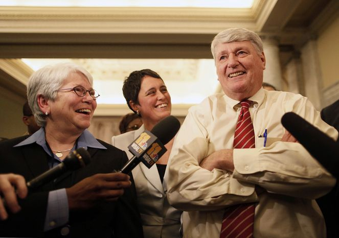 Rep. Maggie McIntosh, Baltimore City Democrat, left, and Rep. Heather Mizeur, Montgomery Democrat, both openly gay members of the Maryland House of Delegates, speak with reporters alongside Speaker of the House of Delegates Michael Busch in Annapolis, Md., Friday, Feb. 17, 2012, after the House passed a gay marriage bill. (AP Photo/Patrick Semansky)