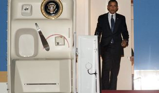 President Obama exits Air Force One on Feb. 18, 2012, after landing at Andrews Air Force Base, Md. (Associated Press)
