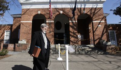 Commonwealth Attorney Warner Chapman leaves the Charlottesville Circuit courthouse after another delay in the trial of George Huguely V in Charlottesville, Va., Friday, Feb. 17, 2012. (AP Photo/Steve Helber)