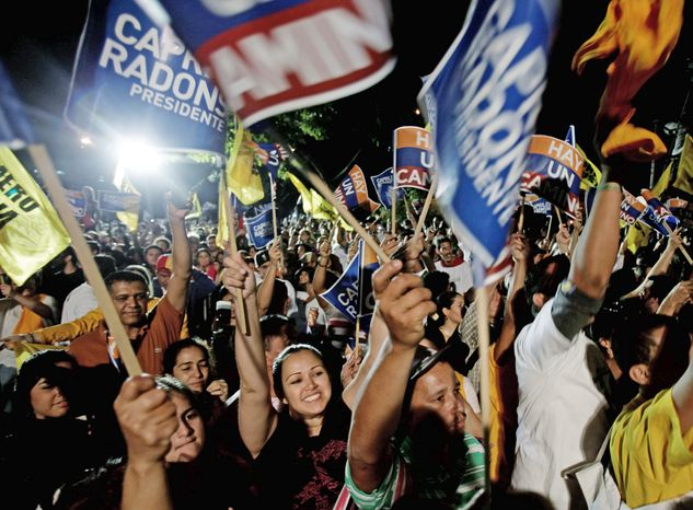 Supporters of Henrique Capriles celebrate in Caracas, Venezuela, on Feb. 12 after he won the opposition's presidential-primary election by a wide margin, setting up an October showdown with the incumbent. (Associated Press)