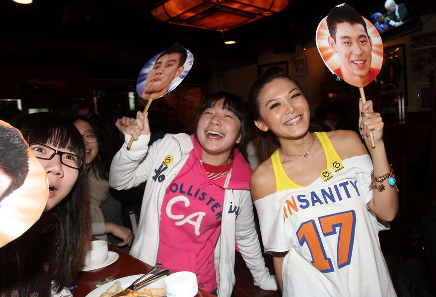 Fans watch from a sports bar in Taipei, Taiwan, as Jeremy Lin scored 26 points in New York's 89-85 loss to New Orleans on Saturday. (Associated Press)