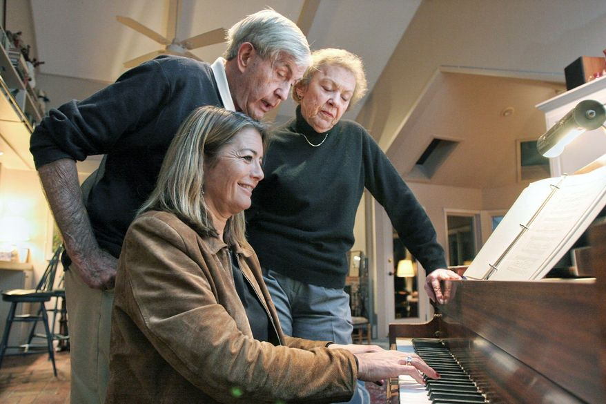 Chicago radio news anchor Mary Ellen Geist plays the piano as her musician father, Woody Geist, and mother, Rosemary Geist, look on. Her father, now deceased, had Alzheimer's disease for the last decade of his life, but music proved palliative (Fabrizio Constantini/Special to The Washington Times)