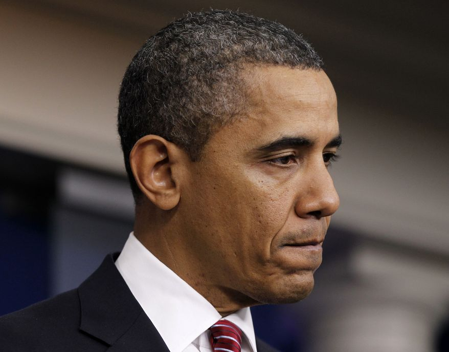 President Barack Obama pauses while announcing the revamp of his contraception policy requiring religious institutions to fully pay for birth control, Friday, Feb. 10, 2012, in the Brady Press Briefing Room of the White House in Washington. (AP Photo/Pablo Martinez Monsivais)