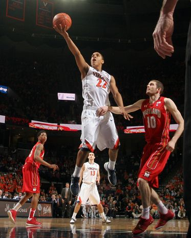 Virginia guard Malcolm Brogdon (22) shoots the ball in front of Maryland center Berend Weijs (10) during the second half of an NCAA basketball game Saturday Feb. 18, 2012 in Charlottesville, Va. Virginia defeated Maryland 71-44. (AP Photo/Andrew Shurtleff)