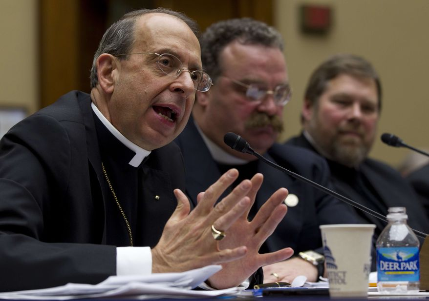 "** FILE ** The Rev. William E. Lori, Roman Catholic bishop of Bridgeport, Conn., gestures while testifying on Capitol Hill in Washington, Thursday, Feb. 16, 2012, before the House Oversight and Government Reform committee hearing: ""Lines Crossed: Separation of Church and State. Has the Obama Administration Trampled on Freedom of Religion & Freedom of Conscience."" From left are, Lori, the Rev. Dr. Matthew C. Harrison, president of the Lutheran Church Missouri Synod, and C. Ben Mitchell, professor of Moral Philosophy Union University. (AP Photo/Carolyn Kaster)"