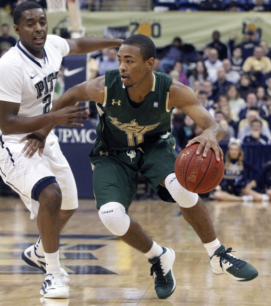 South Florida's Anthony Collins (11), drives past Pittsburgh's Isaiah Epps in the first half of an NCAA basketball game, Sunday, Feb. 19, 2012, in Pittsburgh. South Florida won 56-47. (AP Photo/Keith Srakocic)