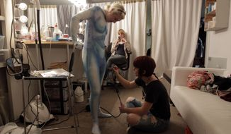 Crew members work on a costume at the Maker Studios in Culver City, Calif., on Dec. 16, 2011. The $100 million investment by YouTube in 96 new channels starting in October has sparked a flurry of activity in Hollywood's independent producer community. (Associated Press)