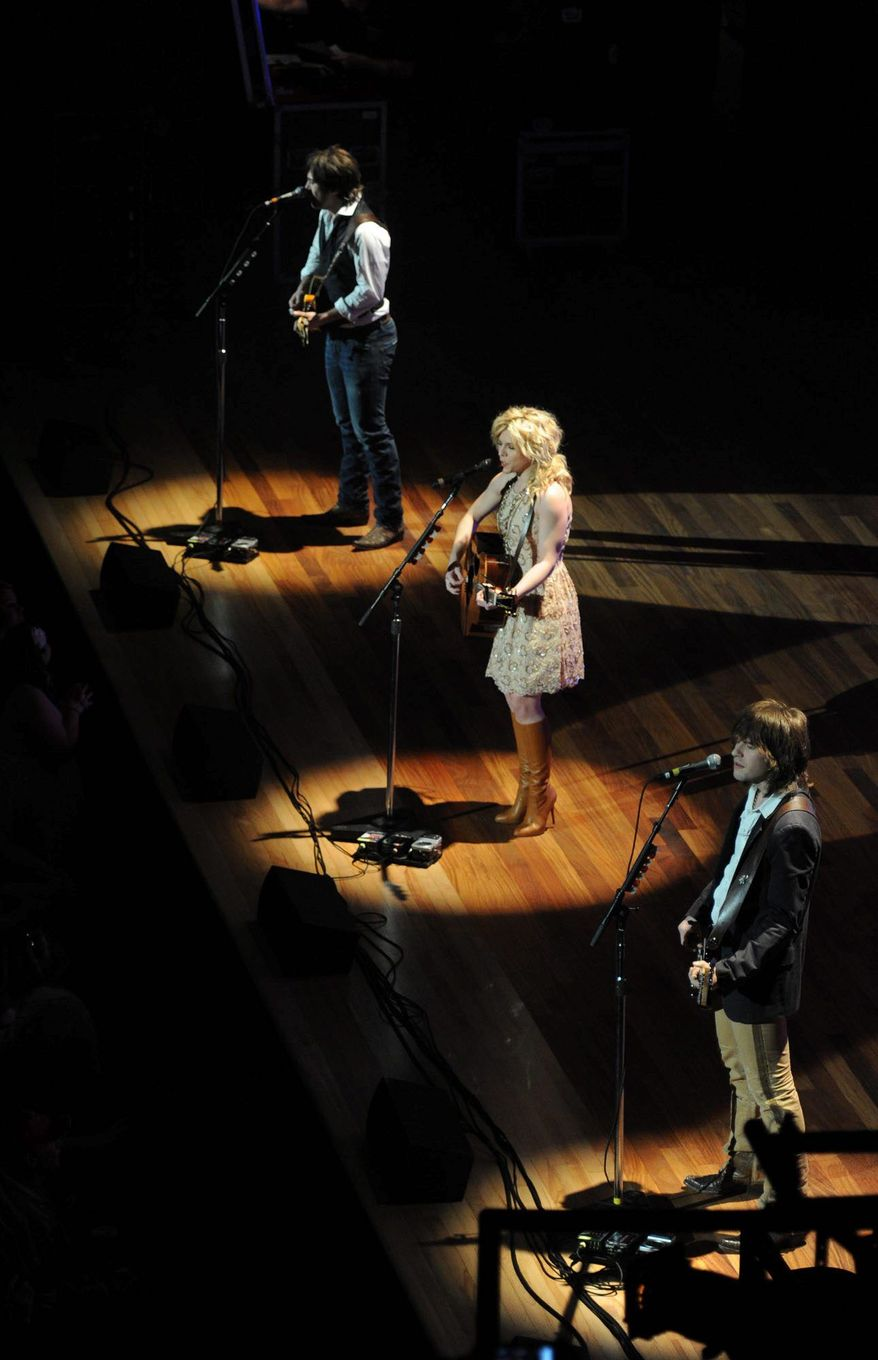 The Band Perry perform Monday on the new stage at Ryman Auditorium, which is often billed as the Mother Church of Country Music. It was the first public performance since the 61-year-old oak floor at the venue was replaced. (Tennessean via Associated Press)