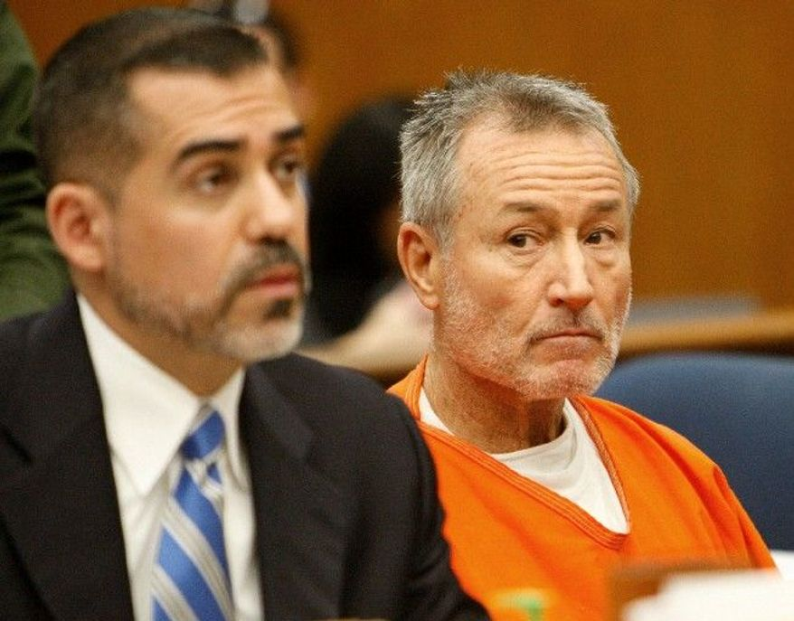 Mark Berndt (right), a former teacher at Miramonte Elementary School, looks to his attorney, Victor Acevedo, during his arraignment in Los Angeles Municipal Court on Tuesday. Mr. Berndt, 61, pleaded not guilty to lewd acts charges. (Associated Press)