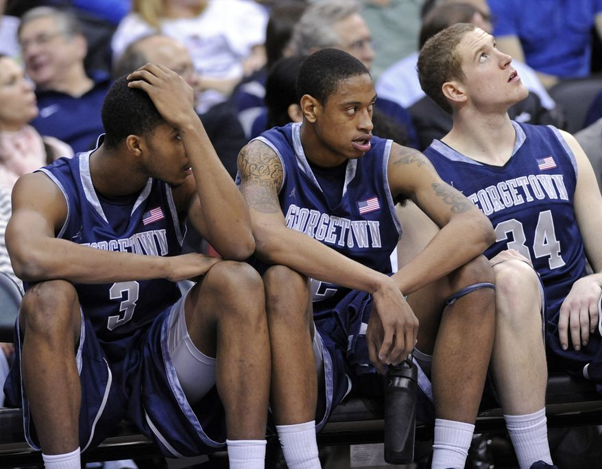 Georgetown's Mikael Hopkins, left, Greg Whittington and Nate Lubick, right, look on from the bench during the second half against Seton Hall, Tuesday, Feb. 21, 2012, in Newark, N.J. Seton Hall defeated Georgetown 73-55. (AP Photo/Bill Kostroun)