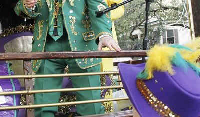 Pete Fountain and Phyllis Landrieu toast the start of Mardi Gras as his Half Fast Marching Club begins its parade through the streets of New Orleans, Tuesday, Feb. 21, 2012. This is the last day of the Mardi Gras celebration ending at midnight, after a day long celebration of parades, marching groups and people in costumes. (AP Photo/Bill Haber)