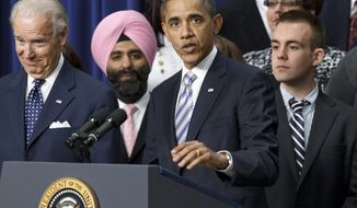President Obama, accompanied by Vice President Joseph R. Biden Jr. (left), talks on Tuesday, Feb. 21, 2012, about the importance of the payroll-tax cut and jobless-benefits extension passed by Congress last week. Joining the president and vice president at the Eisenhower Executive Office Building at the White House complex in Washington are people who posted comments on the White House website about how the tax cut would affect them. (AP Photo/J. Scott Applewhite)