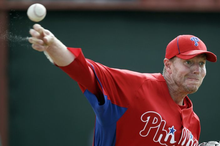 Philadelphia Phillies' Roy Halladay throws during practice at spring training, Sunday, Feb. 19, 2012, in Clearwater, Fla. (AP Photo/Matt Slocum)