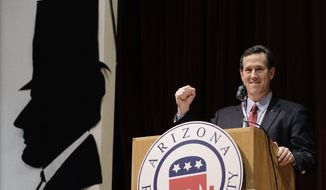 Republican presidential candidate and former Pennsylvania Sen. Rick Santorum pumps his fist Feb. 21, 2012, during a campaign stop at the Maricopa County Lincoln Day Luncheon in Phoenix. (Associated Press)