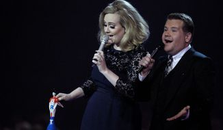 The Brit Awards apologized for cutting off Adele's speech as she accepted an award Tuesday. Adele is shown onstage with awards show host actor James Corden. (Associated Press)