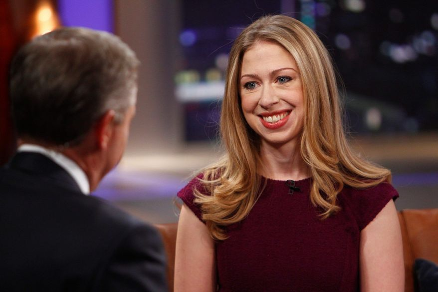 """** FILE ** NBC's Brian Williams, host of """"Rock Center with Brian Williams,"""" interviews Chelsea Clinton, daughter of former President Bill Clinton and former Secretary of State Hillary Clinton, on Dec. 12, 2012, in New York. (Associated Press)"""