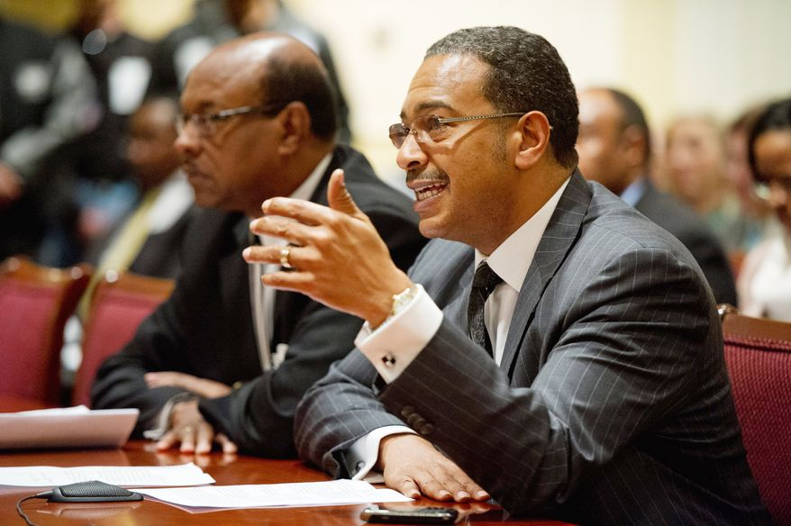 Maryland state Sen. C. Anthony Muse testifies Wednesday at a Senate Budget and Taxation Committee hearing about a proposal to add slots at the National Harbor development in Prince George's County. He recommended more planning and local input before any decision. (Andrew Harnik/The Washington Times)
