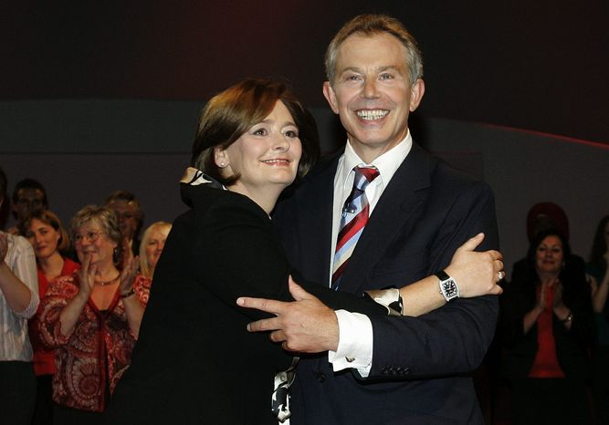 **FILE** Former Britain Prime Minister Tony Blair hugs his wife, Cherie, after delivering the keynote speech at the Labour Party conference in Manchester, England, on Sept. 26, 2006. (Associated Press)