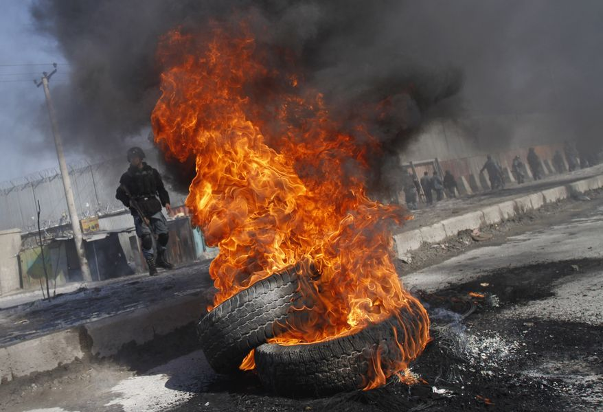 Tires burn during an anti-U.S. demonstration in Kabul, Afghanistan, on Wednesday, Feb. 22, 2012, to protest the burning of Qurans, the Muslim holy book, at the Bagram Airfield military base. (AP Photo/Ahmad Jamshid)