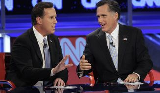Former Massachusetts Gov. Mitt Romney (right) and former Pennsylvania Sen. Rick Santorum argue a point Feb. 22, 2012, during a Republican presidential debate in Mesa, Ariz. (Associated Press)
