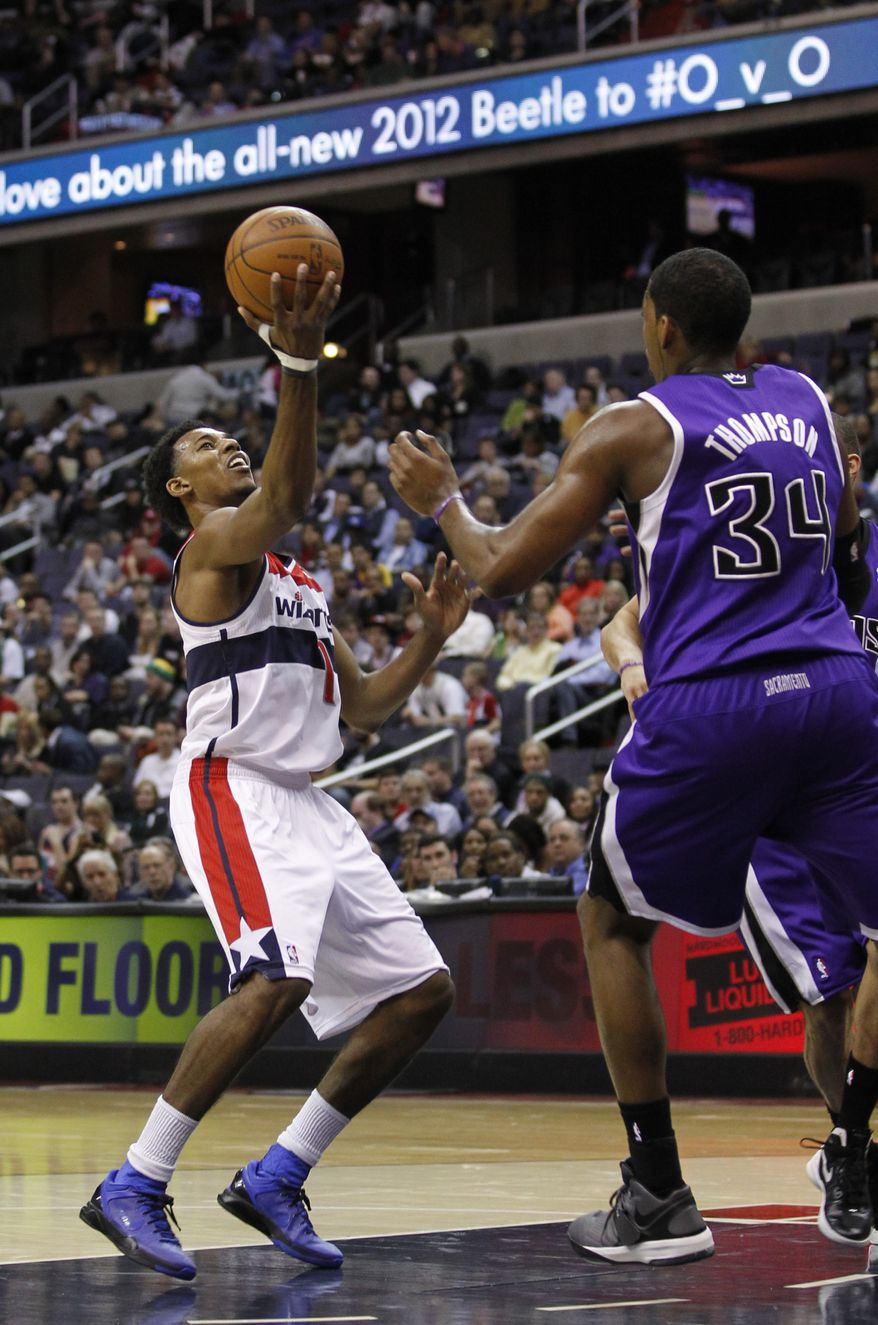 Washington Wizards shooting guard Nick Young (1) grabs the ball during the second half against the Sacramento Kings, Wednesday, Feb. 22, 2012, in Washington. The Kings won 115-107. (AP Photo/Haraz N. Ghanbari)