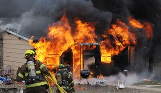 **FILE** Firefighters battle a blaze from a shake-and-bake meth lab explosion, in Union, Mo., on Jan. 29, 2010. (Associated Press/Franklin County Sheriff's Department)