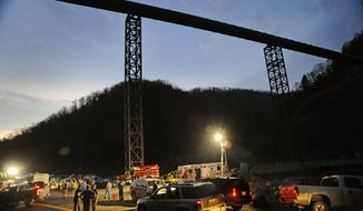 **FILE** West Virginia State Police direct traffic April 5, 2010, at the entrance to Massey Energy's Upper Big Branch Coal Mine in Montcoal, W.Va. (Associated Press)