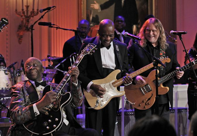 B.B. King (left), Buddy Guy (center) and Warren Haynes perform in recognition of Black History Month on Tuesday, Feb. 21, 2012, in the East Room of the White House in Washington. (AP Photo/Pablo Martinez Monsivais)