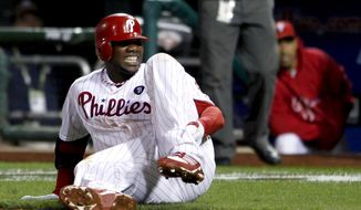 FILE - In this Oct. 7, 2011, file photo, Philadelphia Phillies' Ryan Howard reacts after tearing his left Achilles tendon on his way to first base during the ninth inning of Game 5 of the National League division baseball series against the St. Louis Cardinals, in Philadelphia. (AP Photo/Alex Brandon, File)