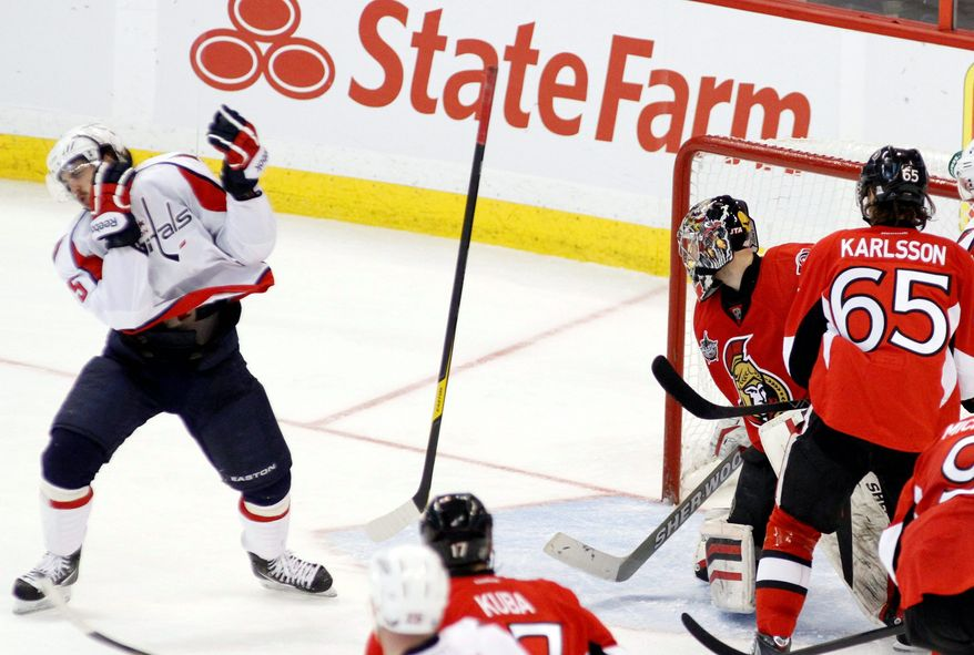 With three straight losses and six in their past seven games, the Capitals have fallen on hard times. Even the goals they score don't come easily: Mathieu Perreault was struck in the face by this shot, and the puck bounced past Ottawa goalie Craig Anderson during Wednesday night's 4-2 loss. (Associated Press)