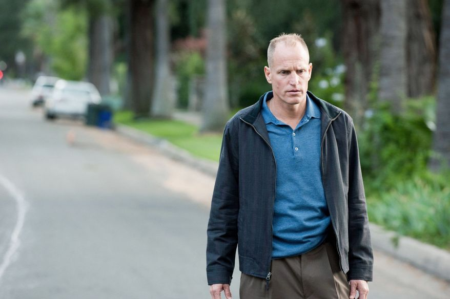 """Woody Harrelson's L.A. cop in """"Rampart"""" keeps his audience guessing whether his thuggishness is the desperation of a basically decent man or is his bitter true self. (Millenium Entertainment via Associated Press)"""