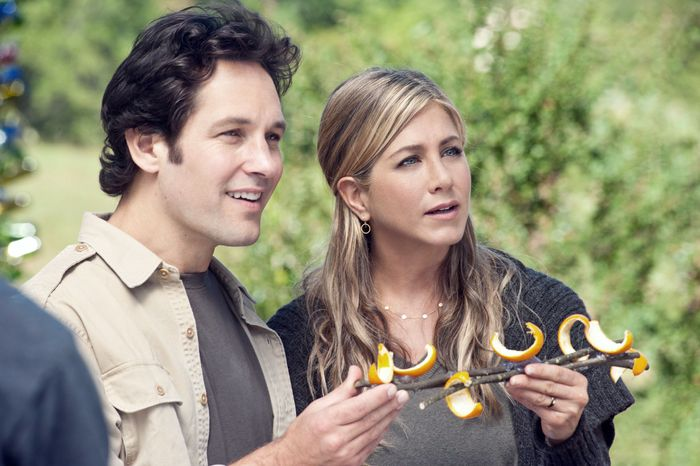 """Paul Rudd and Jennifer Aniston play a New York couple who hit the road after losing their jobs. They end up in a wacky commune in """"Wanderlust."""" (Universal Pictures via Associated Press)"""