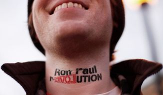 Landon Cook, of Boston, wears an imitation tattoo on his neck in support of Republican presidential candidate Rep. Ron Paul. One in five Americans has a tattoo, according to Harris Polls. (Associated Press)