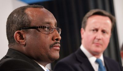 British Prime Minister David Cameron listens Thursday as Prime Minister of the Transitional Federal Government of Somalia Abdiweli Mohamed Ali speaks at a press conference in London. A one-day conference on Somalia was attended by representatives of 40 governments to discuss terrorism, famine and security issues involving Somalia. (Associated Press)