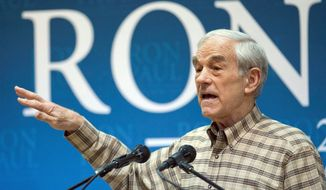 Rep. Ron Paul's budget plans include eliminating five Cabinet departments, ending operations in Iraq and Afghanistan, and cutting federal programs. (Idaho Statesman via Associated Press)