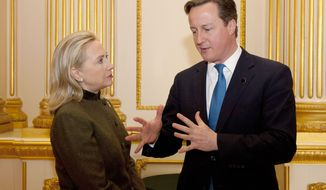 British Prime Minister David Cameron (right) talks with U.S. Secretary of State Hillary Rodham Clinton during the Somalia Conference at Lancaster House in London on Thursday, Feb. 23, 2012. (AP Photo/Matt Dunham, Pool)
