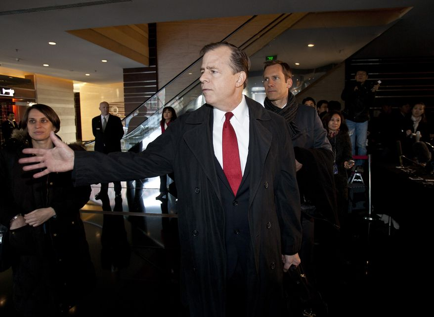 Glyn Davies (center), U.S. envoy on North Korean affairs, speaks to U.S. Embassy staff at a hotel in Beijing before heading to nuclear talks with North Korean officials on Thursday, Feb. 23, 2012. (AP Photo/Andy Wong)