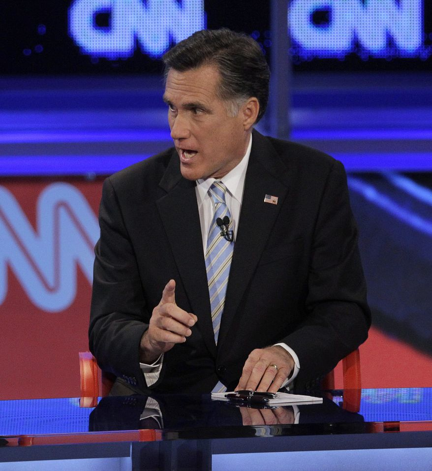Former Massachusetts Gov. Mitt Romney gestures during a Republican presidential debate Wednesday, Feb. 22, 2012, in Mesa, Ariz. (AP Photo/Jae C. Hong)