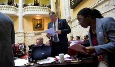 Maryland State Sen. Edward R. Reilly, Anne Arundel County Republican, looks over paperwork Feb. 23, 2012, at the State House in Annapolis, as the Senate passed the Civil Marriage Protection Act. (Rod Lamkey Jr./The Washington Times)