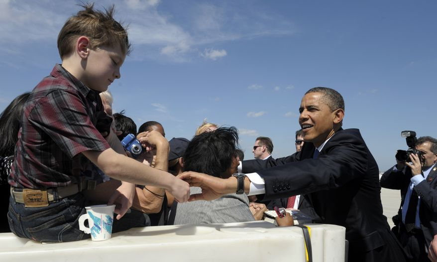 President Obama greets supporters Feb. 23, 2012, after arriving at the Miami International Airport. (Associated Press)