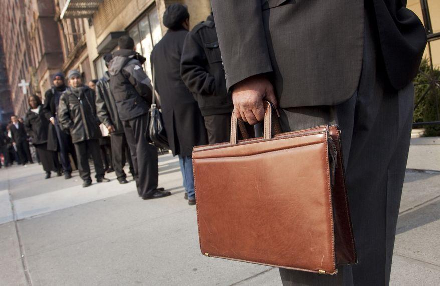 Dozens of job seekers line up to enter a National Career Fair on Wednesday, Feb. 22, 2012, in New York. (AP Photo/Mark Lennihan)