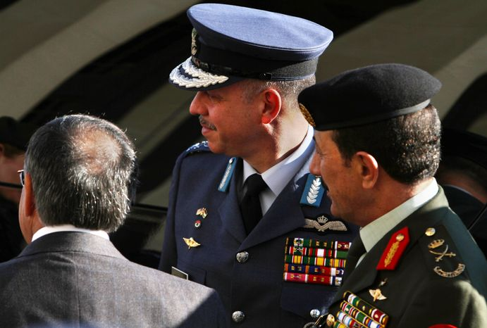 Secretary of Defense Leon E. Panetta (left, with back to camera) greets Lt. Gen. Prince Feisal bin Hussein (center) and Lt. Gen. Mashal al-Zaben of Jordan on their arrival at the Pentagon on Thursday, Feb. 23, 2012. (AP Photo/Jacquelyn Martin)