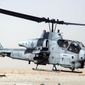 """** FILE ** An AH-1W """"Cobra"""" helicopter similar to this one collided with another Marine chopper during night-training exercises on Wednesday, Feb. 22, 2012, near Yuma, Ariz. (AP Photo/US Marines)"""