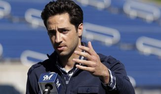 Milwaukee Brewers' Ryan Braun speaks during a news conference at baseball spring training in Phoenix, Friday, Feb. 24, 2012. National League MVP Braun's 50-game suspension was overturned Thursday by baseball arbitrator Shyam Das, the first time a baseball player successfully challenged a drug-related penalty in a grievance. (AP Photo/Jae C. Hong)