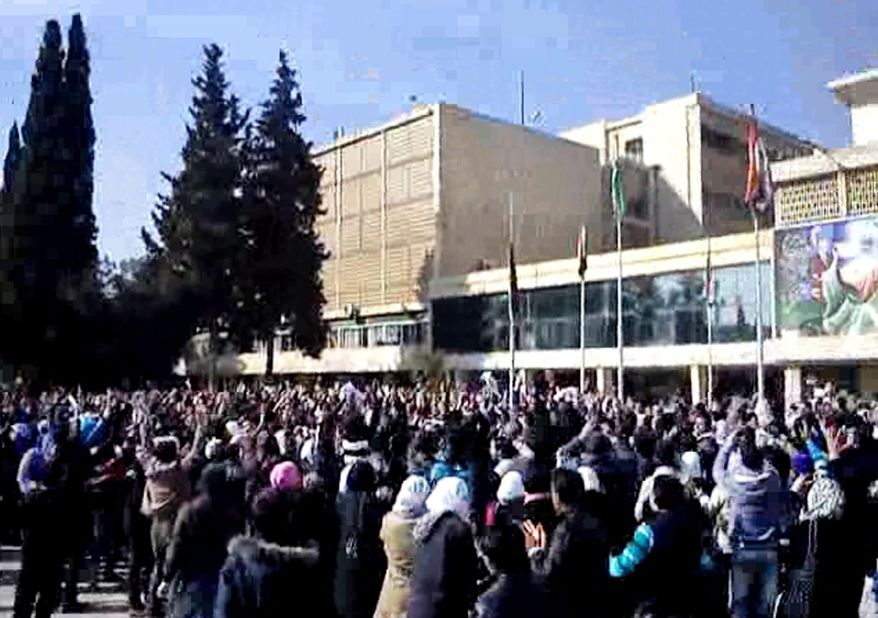 Syrian student protesters chant slogans during a Feb. 22, 2012, demonstration against Syrian President Bashar Assad at the Aleppo University's Square, in the northern city of Aleppo, Syria. (Associated Press/Local Coordination Committees in Syria)