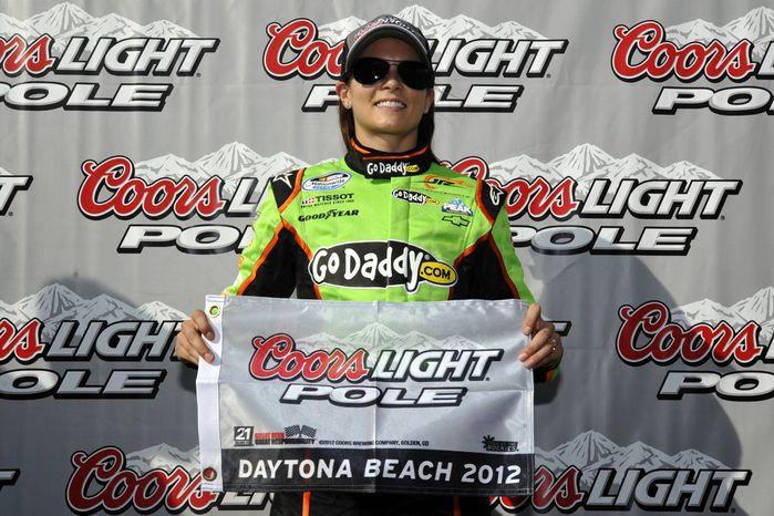 Danica Patrick poses after winning the pole position for Saturday's NASCAR Drive4COPD 300 auto race in Daytona Beach, Fla., Friday, Feb. 24, 2012. (AP Photo/Rainier Ehrhardt)