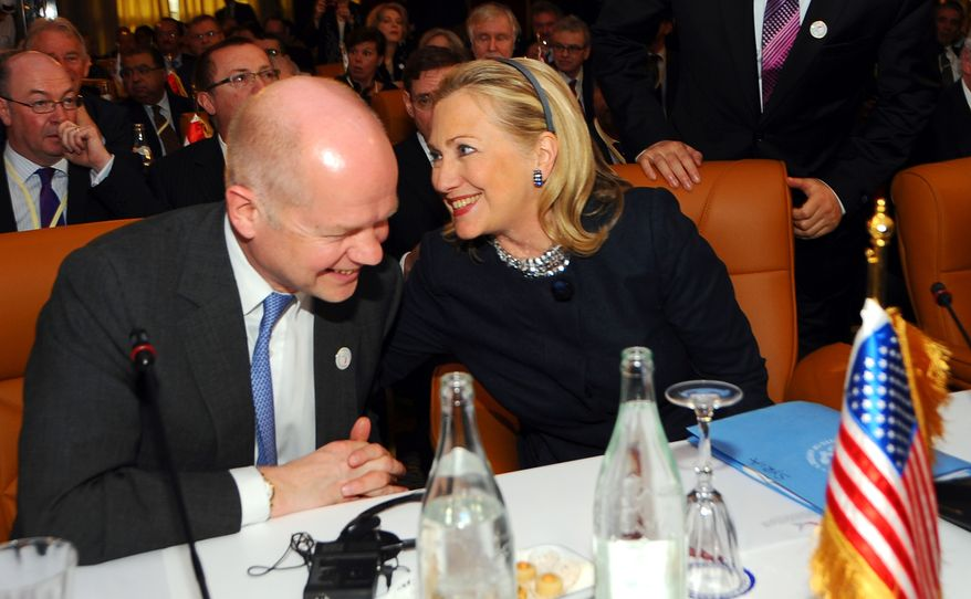 U.S. Secretary of State Hillary Rodham Clinton sits next to British foreign minister William Hague at the start of the Conference on Syria in Tunis, Tunisia, on Feb. 24, 2012. (Associated Press)