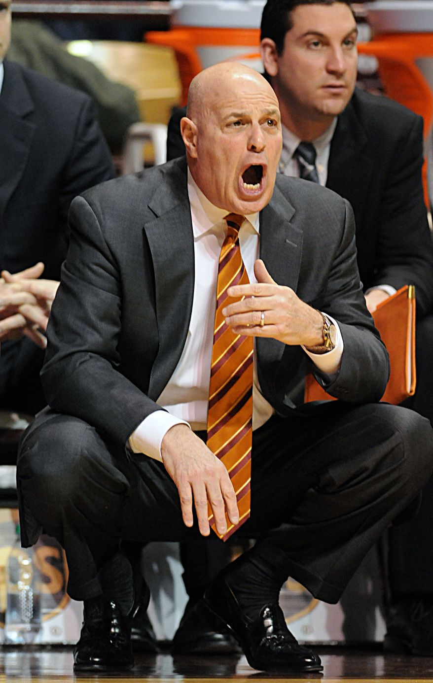 Virginia Tech coach Seth Greenberg yells to his players during the first half against Virginia on Tuesday, Feb. 21, 2012, at Cassell Coliseum in Blacksburg, Va. (AP Photo/Don Petersen)