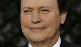 ** FILE ** In this May 4, 2011, file photo, Billy Crystal arrives at the Academy of Motion Picture Arts and Sciences Tribute honoring Sophia Loren in Beverly Hills, Calif. Crystal returns as host for the 84th Academy Awards on Sunday, Feb. 26, 2012. (AP Photo/Matt Sayles, file)